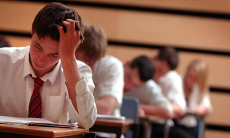 Pupils sit exams in a school hall