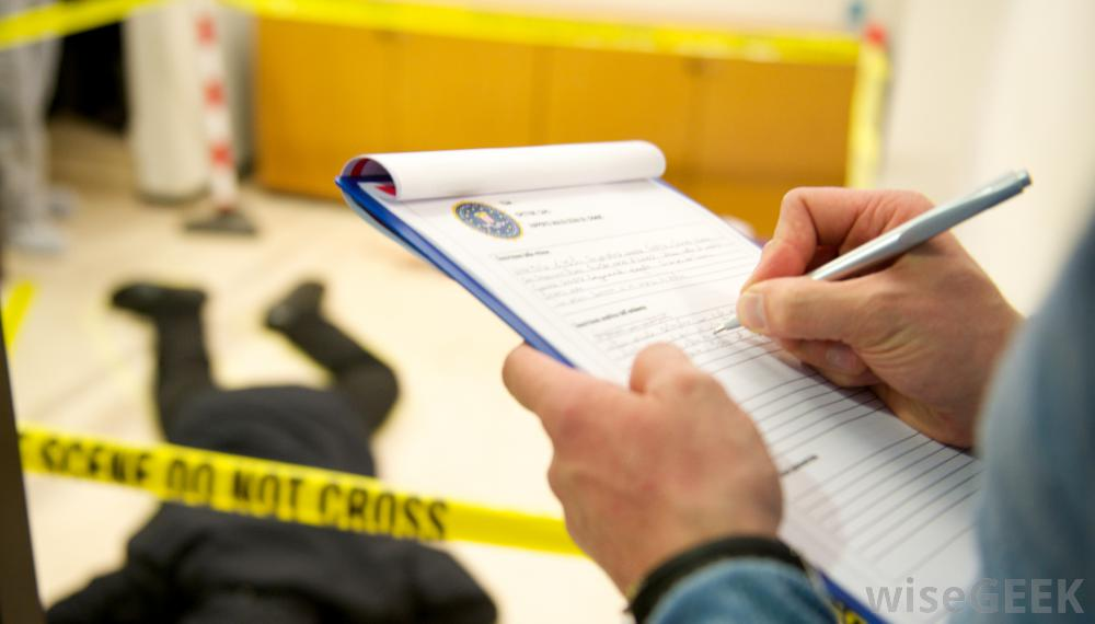 man-taking-notes-at-crime-scene